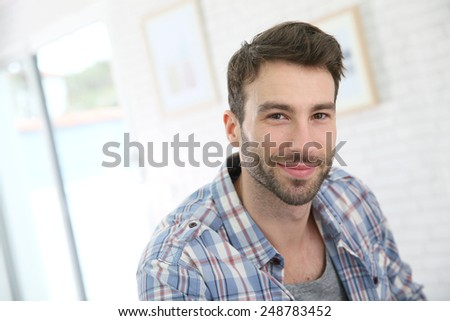 Portrait of cheerful 30-year-old man - stock photo