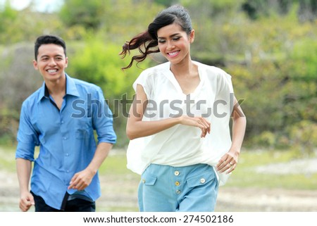 portrait of cheerful young couple have fun on their vacation - stock photo