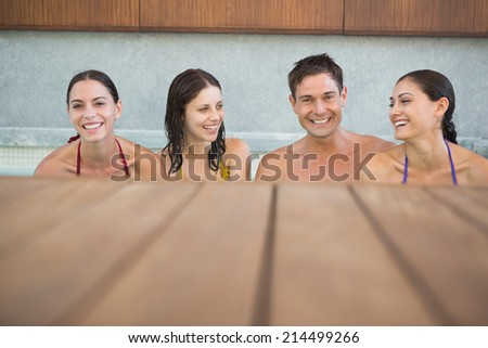 Portrait of cheerful young people in the swimming pool - stock photo