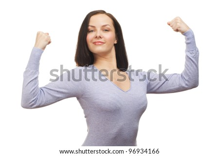 Portrait of cheerful young woman flexing her biceps isolated over white background
