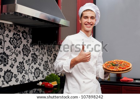 Portrait of chef appreciating meal with hand gesture