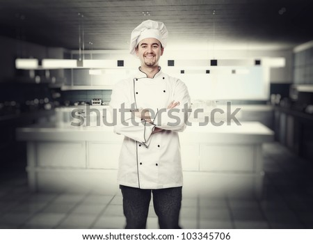portrait of chef in modern kitchen - stock photo