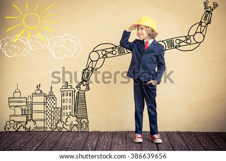 Portrait of child builder in office. Success, creative and innovation business concept - stock photo