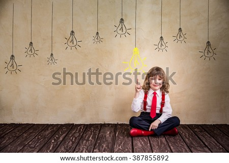 Portrait of child businessman in office. Success growing business concept - stock photo