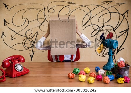 Portrait of child businessman in office. Think outside the box concept - stock photo
