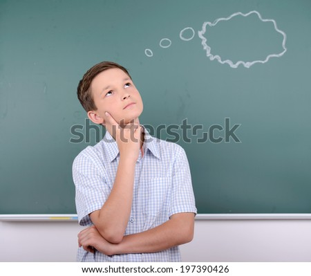 Portrait of child school education against the background of blackboard - stock photo