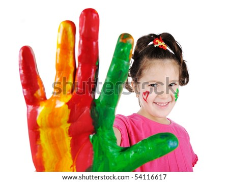 Portrait of child with colored hand - stock photo
