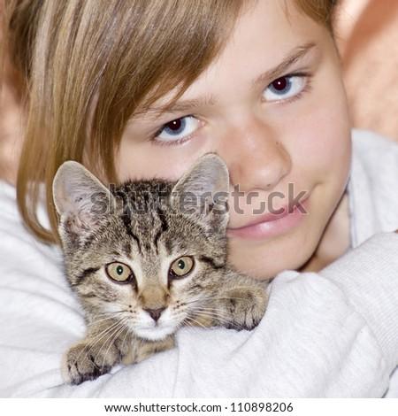 Portrait of child with kitten - stock photo