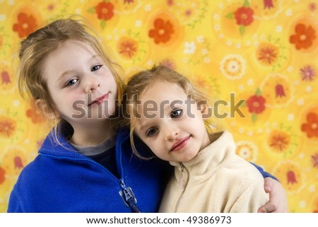 Portrait of children on a yellow floral backgound - stock photo