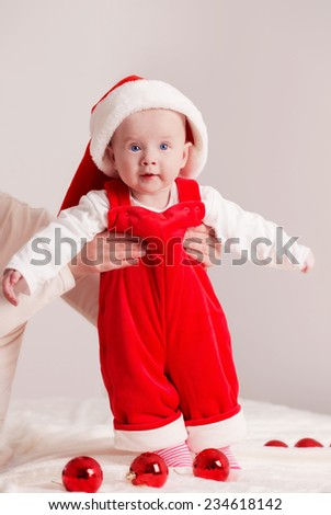 Portrait of Christmas baby in mother hands