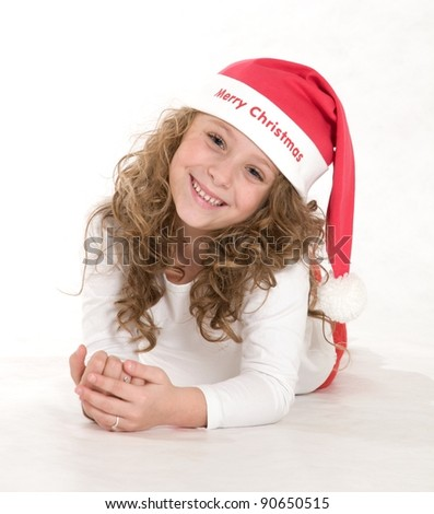 Portrait of Christmas baby  in  Santa hat - stock photo