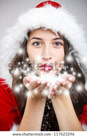 Portrait of christmas girl blowing snow - stock photo