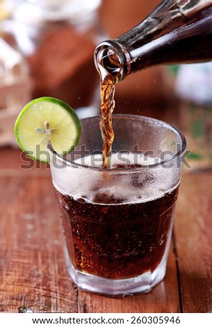 portrait of cola poured into a glass - stock photo