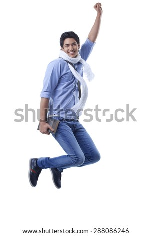 Portrait of college student jumping over white background