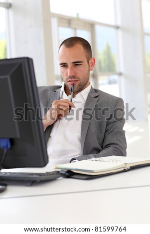 Portrait of concentrated businessman at work - stock photo