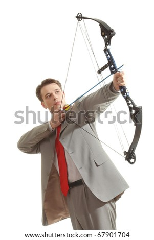 Portrait of concentrated male with crossbow in hands over white background - stock photo