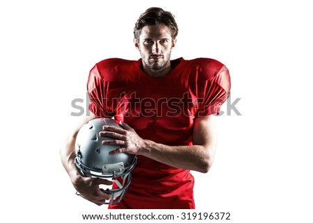 Portrait of confident American football player in red jersey holding helmet on a white background - stock photo