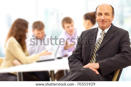 Portrait of confident and successful team of business men smiling - stock photo