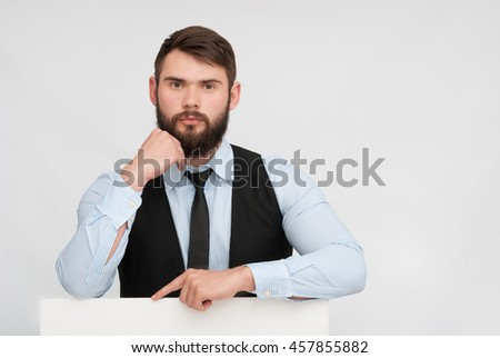 portrait of confident businessman. manager holding a white blank or board