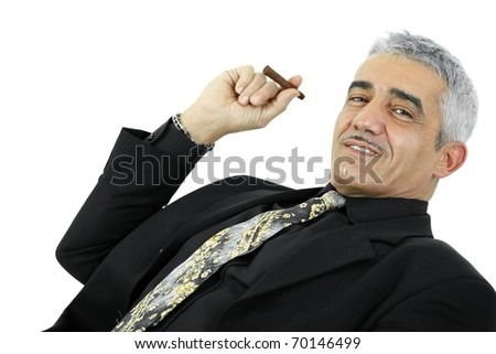 Portrait of confident businessman posing with cigar. Isolated on white.?
