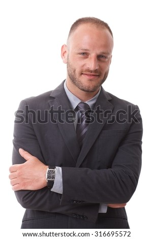 Portrait of confident businessman smiling arms crossed, looking at camera.