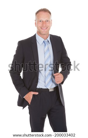 Portrait of confident businessman standing over white background - stock photo