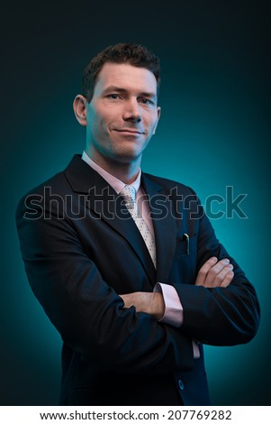 Portrait of confident businessman with his arms folded - stock photo
