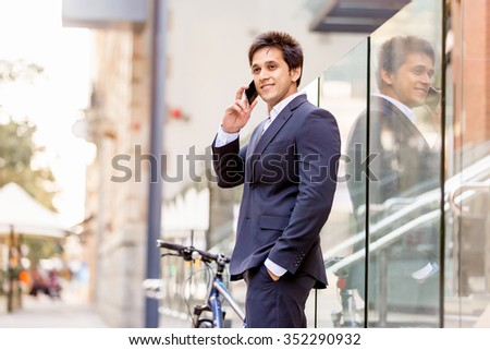 Portrait of confident businessman with his mobile phone outdoors