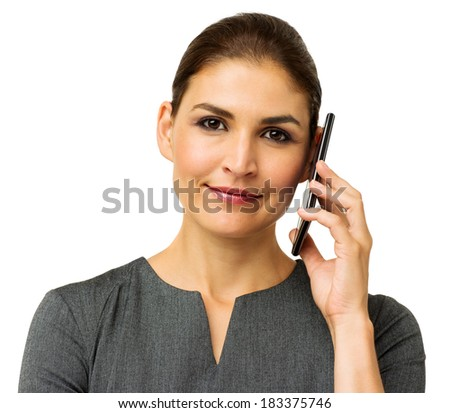 Portrait of confident businesswoman answering smart phone against white background. Horizontal shot.