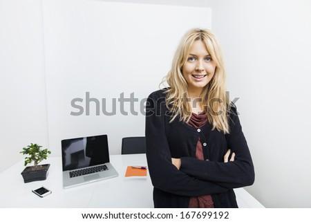 Portrait of confident businesswoman in office - stock photo