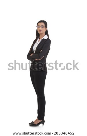 Portrait of confident businesswoman with arms crossed standing against white background - stock photo