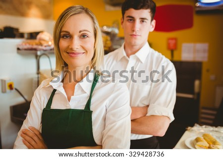 Portrait of confident colleagues in bakery - stock photo