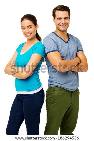 Portrait of confident couple standing arms crossed isolated over white background. Vertical shot. - stock photo