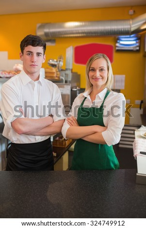 Portrait of confident coworkers in bakery