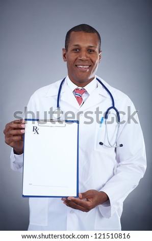 Portrait of confident doctor showing prescription blank - stock photo