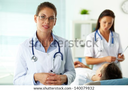 Portrait of confident female doctor looking at camera in hospital