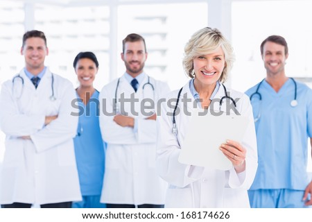 Portrait of confident happy group of doctors standing at the medical office - stock photo