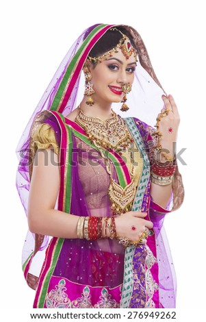 Portrait of confident Indian bride smiling against white background - stock photo