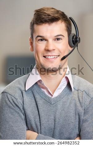 Portrait of confident male customer service representative in corporate office - stock photo