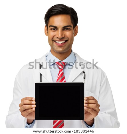 Portrait of confident male doctor showing digital tablet over white background. Horizontal shot.