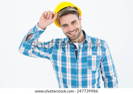 Portrait of confident male technicial wearing hard hat on white background