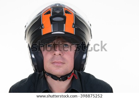Portrait of confident  man wearing  helmet against white background.