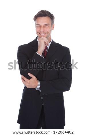 Portrait Of Confident Mature Businessman With Arm Crossed - stock photo