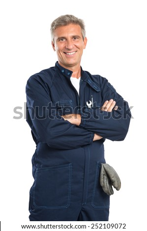 Portrait Of Confident Mature Mechanic In Overalls With Arm Crossed Looking At Camera Isolated On White Background - stock photo