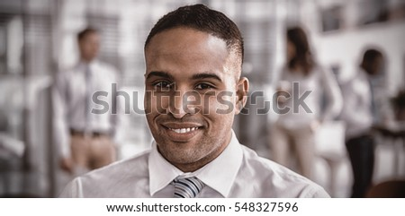 Portrait of confident smiling businessman in office