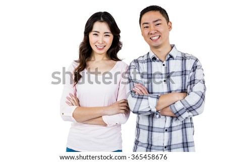 Portrait of confident smiling couple while standing against white background