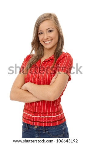 Portrait of confident smiling girl standing arms crossed, smiling at camera.