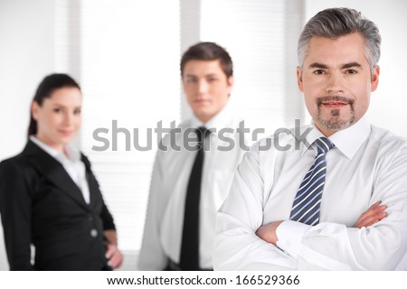 Portrait of Confident successful business man. Blur business people on background