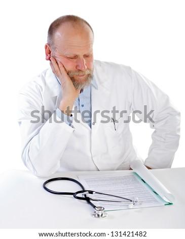 Portrait of confident thinking doctor on white background - stock photo