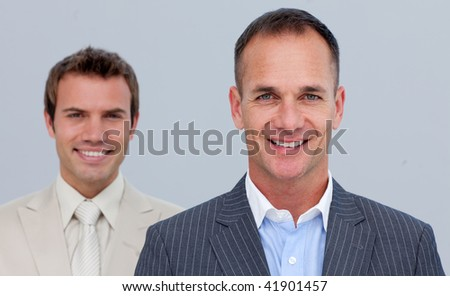 Portrait of confident two businessmen with folded arms - stock photo